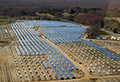 Solar panels being installed - 77,000 strong in one of the largest solar farms in the northeast United States